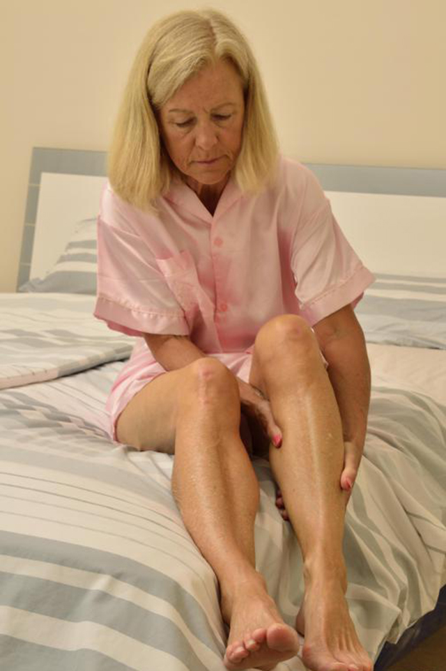 woman-in-pink-with-nighttime-leg-cramps