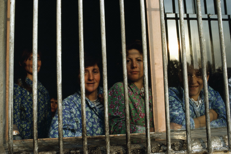 ALBANIA. Sarande. Maternity Hospital. Women have to attend the hospital for 4-5 days and during this time are not allowed visits from their immediate family of other visitors. Husbands and friends deliver presents through the barred windows. 1990.