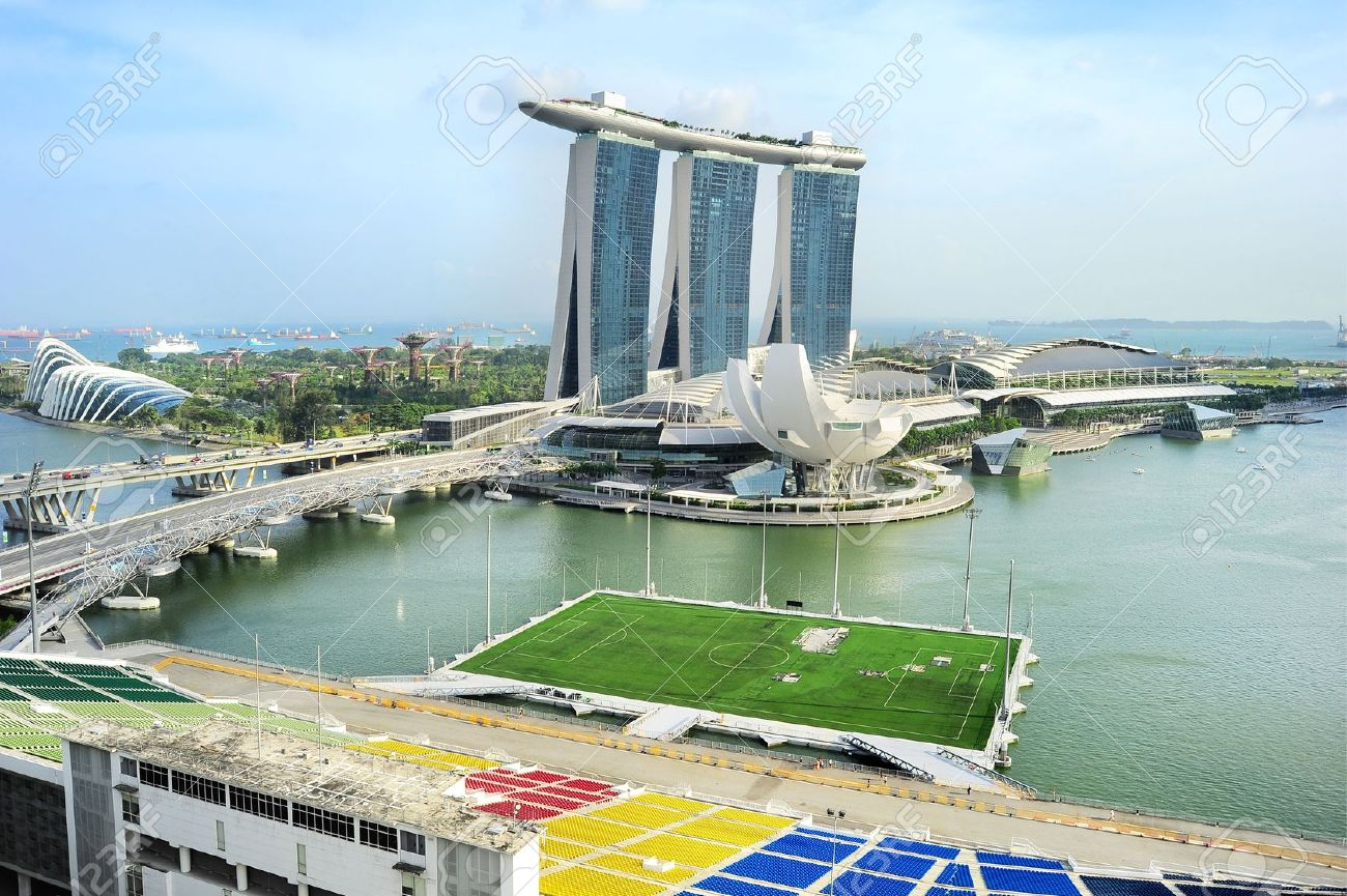 18799425-Aerial-view-on-Marina-Bay-Floating-Platform-Marina-Bay-Sands-resort-and-Garden-by-the-Bay-in-Singapo-Stock-Photo