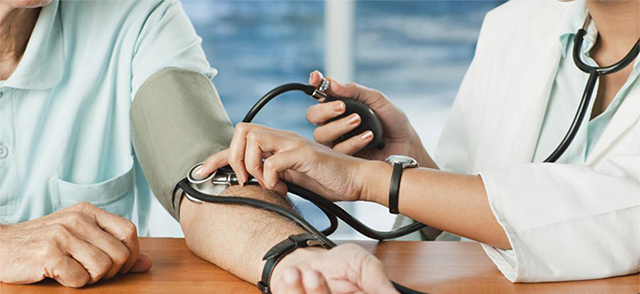 Doctor checking blood pressure to patient