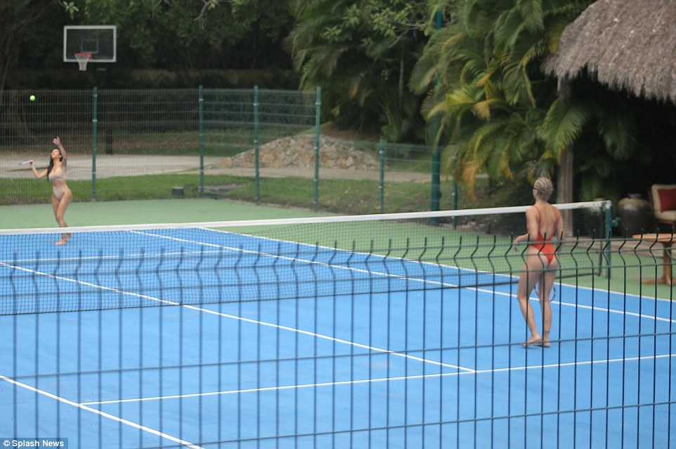 378D89B900000578-3757005-Tropical_twosome_The_duo_made_use_of_a_tennis_court_in_their_lux-m-155_1472066853603