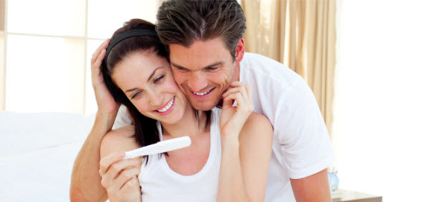 Prengant-couple-reading-positive-pregnancy-test