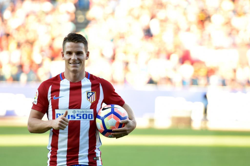 (FILES) This file photo taken on July 31, 2016 shows Atletico de Madrid's new signing French forward Kevin Gameiro posing with a ball during his presentation at the Vicente Calderon stadium in Madrid. Pogba, Umtiti, Digne, Dembele, Kante, Gameiro... French players continue to be popular in Europe, and stirred the transfer market this summer after a beautiful Euro 2016 championship for the French Team and repeated success of the younger players selections. / AFP PHOTO / GERARD JULIEN