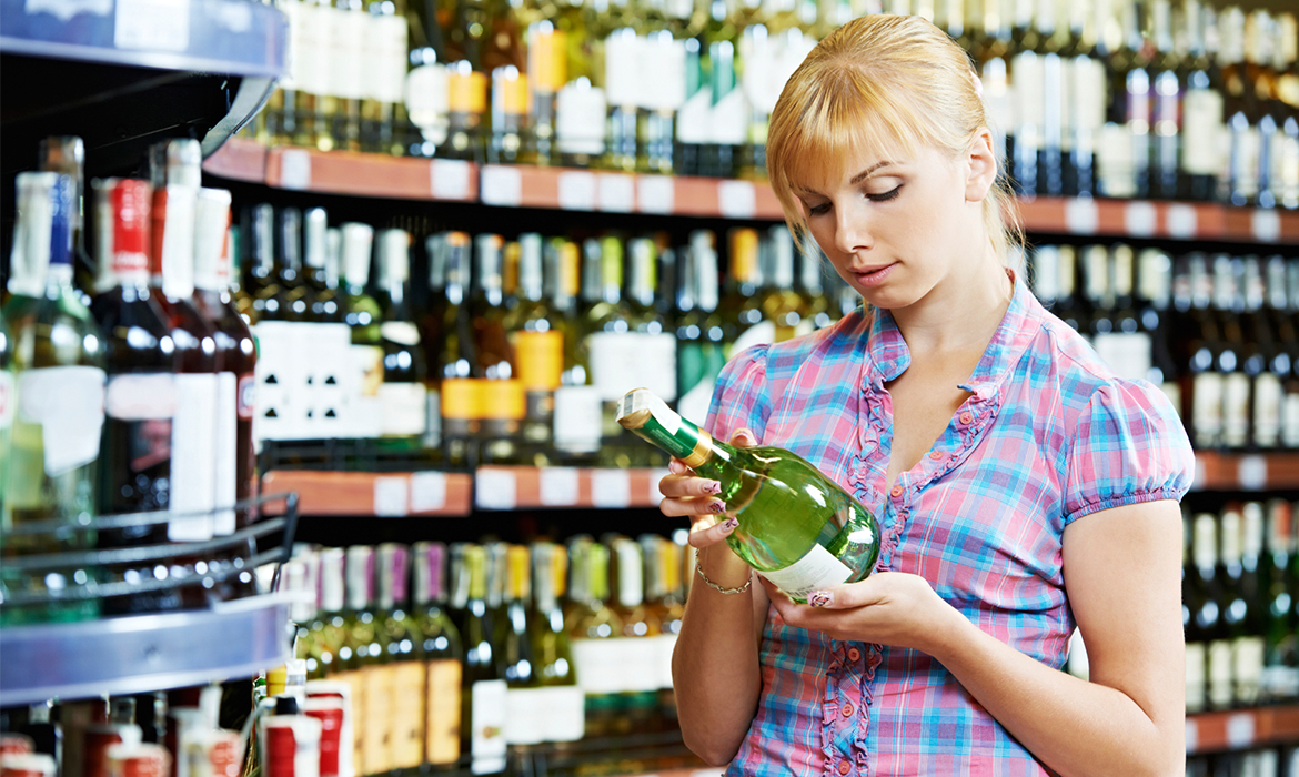 young-woman-buying-alcohol