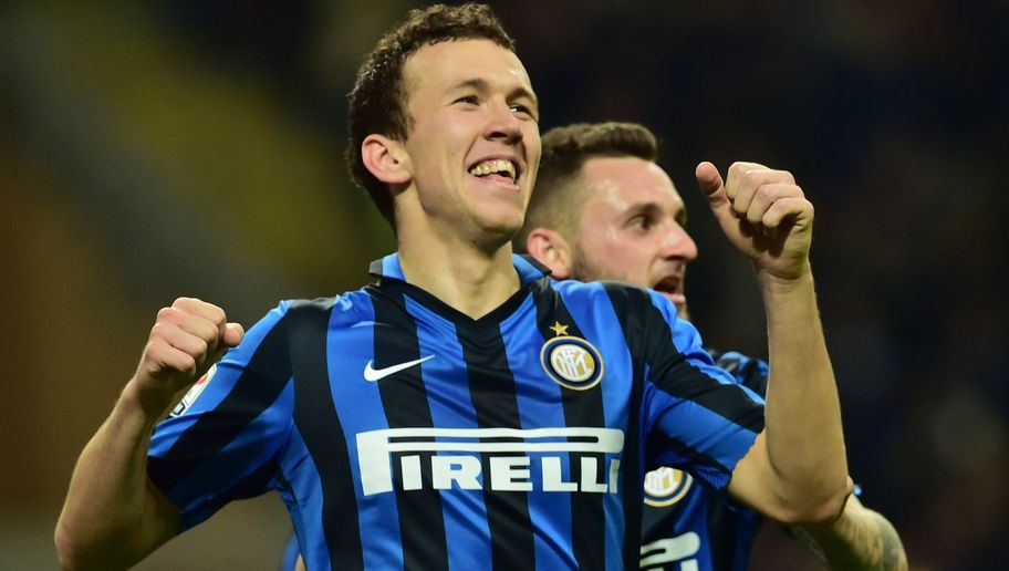Inter Milan's forward from Croatia Ivan Perisic celebrates after scoring a goal during the Italian Serie A football match between Inter Milan and Bologna at the San Siro Stadium in Milan on March 12, 2016. / AFP / GIUSEPPE CACACE        (Photo credit should read GIUSEPPE CACACE/AFP/Getty Images)